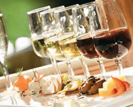 Photo of wine and food at an event