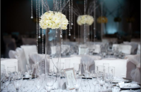 White flowers linens and table decor at an event